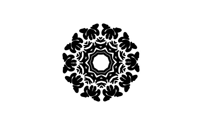 Black mandala graphic on white paper